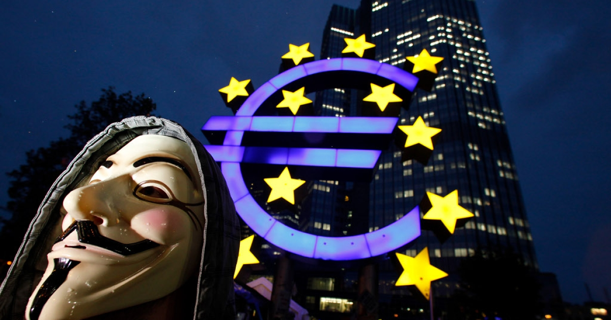 A masked protester, inspired by the Occupy Wall Street protests in the United States stands in front of the headquarters of the European Central Bank (ECB) on October 18, 2011 in Frankfurt am Main, Germany. Around hundred protesters operate a camp outside the ECB to demonstrate against economic and financial policy.</p>