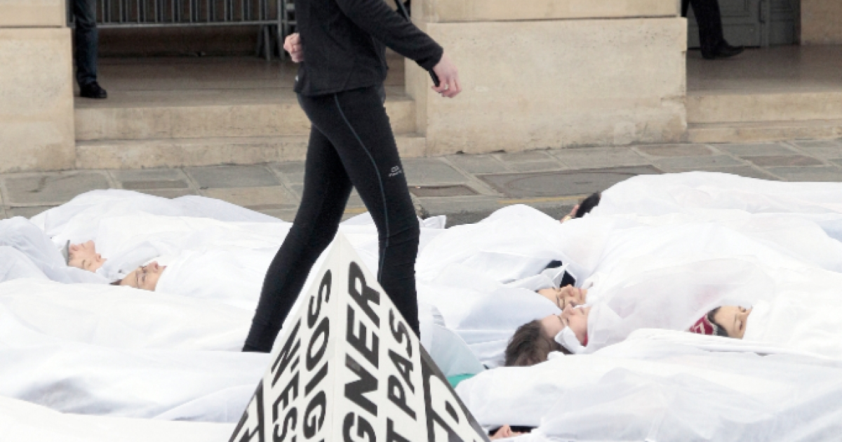 Protesters in Paris lay on the pavement during a demonstration last month against a proposed bill that would legalize euthanasia.</p>