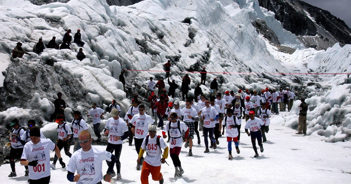 These guys might need a bathroom break... Marathon runners run under a banner at the start of the Everest Hillary Marathon at Everest Base Camp, 29 May 2006. Over 140 marathon runners took part in the race covering 26.2 miles from Everest Base Camp to Namche Bazar from a height of 5,364 meters to 3,446 meters).</p>