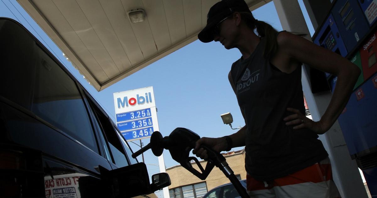 A driver fuels her SUV at an Exxon Mobil gas station in Chicago on July 29, 2010.</p>