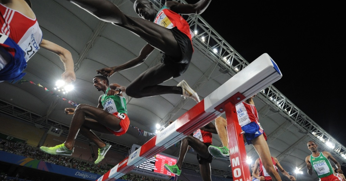 Kenya's Ezekiel Kemboi (C) leaps over the jump during the men's 3,000 metres steeplechase final at the International Association of Athletics Federations (IAAF) World Championships in Daegu on September 1, 2011.</p>