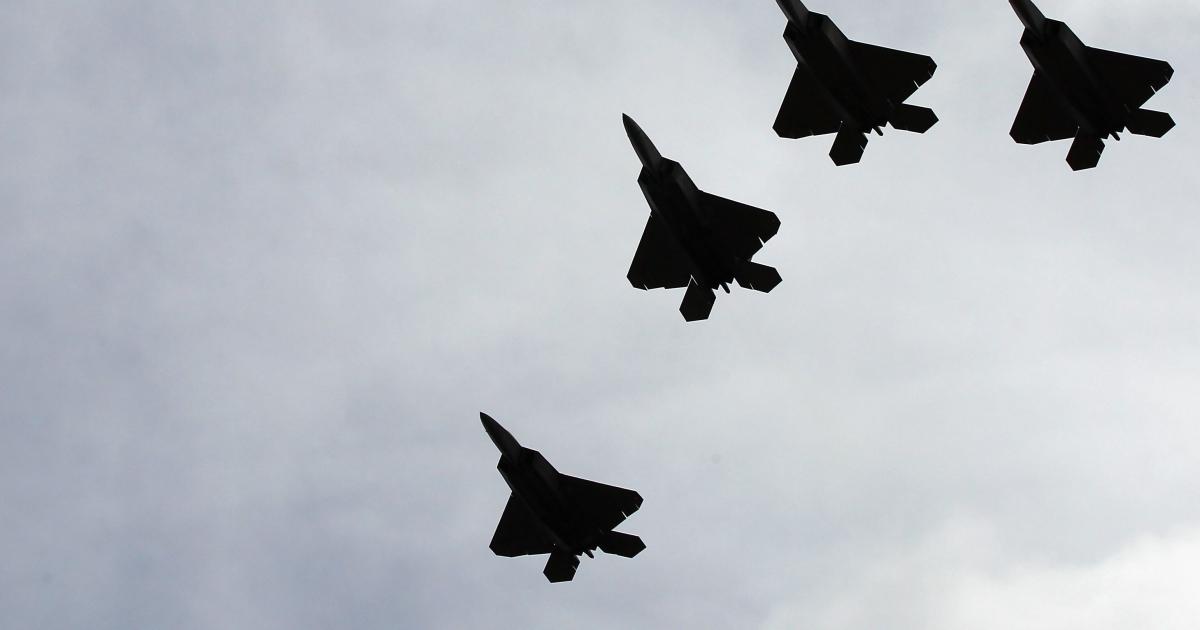 A group of F-22 Raptors perform a flyover during the burial service for former Sen. Ted Stevens (R-Alaska) at Arlington National Cemetery on Sept. 28, 2010.</p>