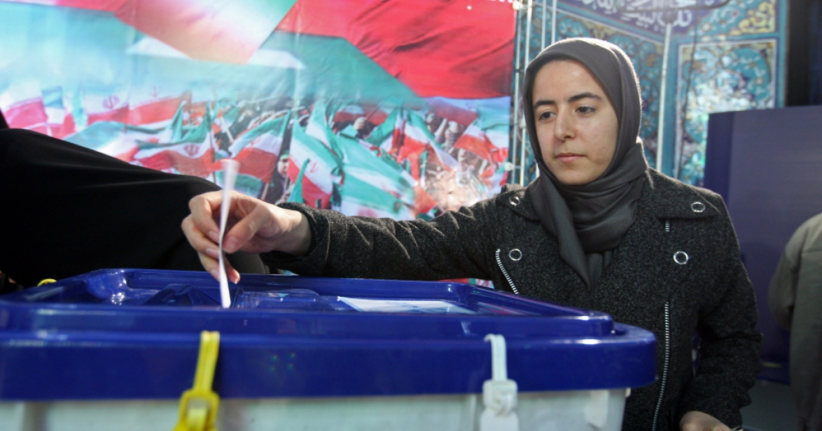 An Iranian woman votes at a polling station in Tehran on March 2, 2012. Iran's 48 million voters are being called on to decide their next parliament today in elections whose turnout will be weighed to give an idea of support for the Islamic republic's regime.</p>