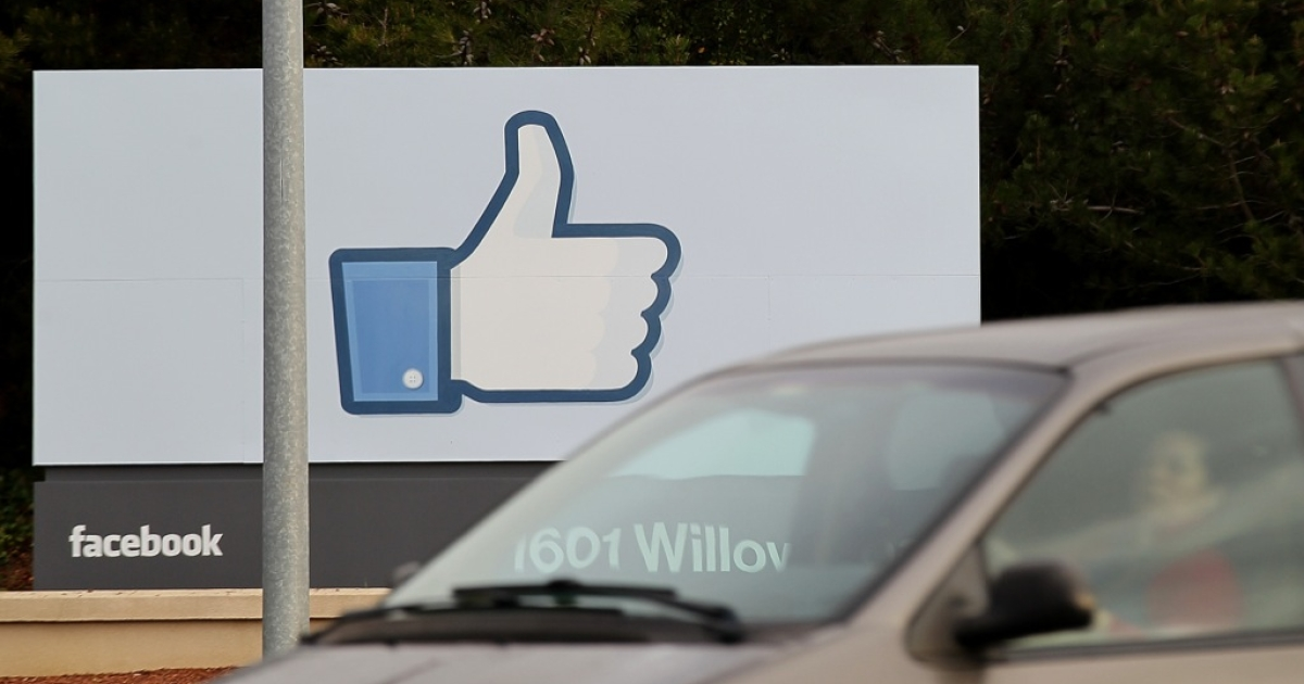 A sign with the 'like' symbol stands in front of the Facebook headquarters on Feb. 1, 2012 in Menlo Park, California. Facebook is expected to file for its first initial public offering seeking to raise at least $5 billion.</p>