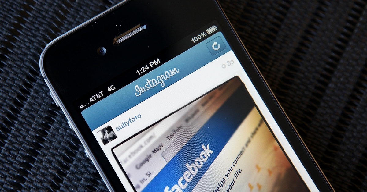 In this photo illustration, an Instagram photo of the Facebook website app is seen on an Apple iPhone on April 9, 2012 in New York City.</p>