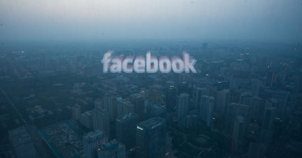 A photo taken on May 16, 2012 shows a computer screen displaying the logo of social networking site Facebook reflected in a window before the Beijing skyline.</p>