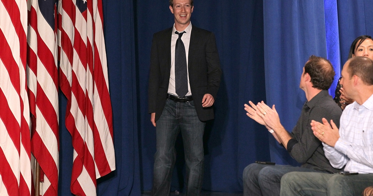 Facebook CEO Mark Zuckerberg arrives at a town hall style meeting with U.S. President Barack Obama at Facebook headquarters on April 20, 2011 in Palo Alto, California.</p>