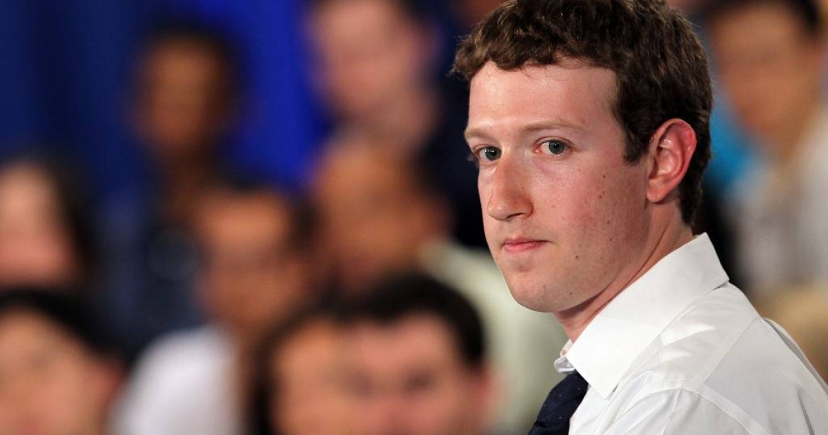 Looking over his shoulder? Facebook CEO Mark Zuckerberg attends a town hall style meeting with U.S. President Barack Obama at Facebook headquarters on April 20, 2011 in Palo Alto, California.</p>