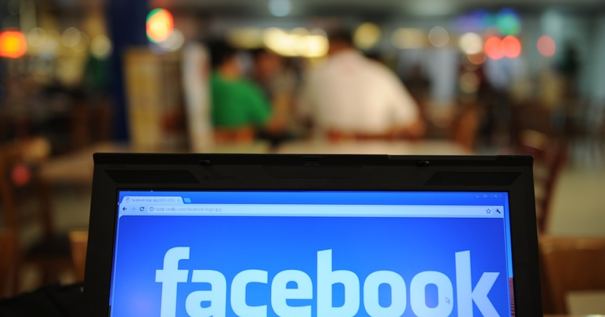 In a picture taken on May 15, 2012, a logo of social networking facebook is displayed on a laptop screen inside a restaurant in Manila. As Facebook nears saturation levels in some Western countries, Asian users are helping drive the social-networking leader's march on the 1-billion-user milestone and beyond.</p>