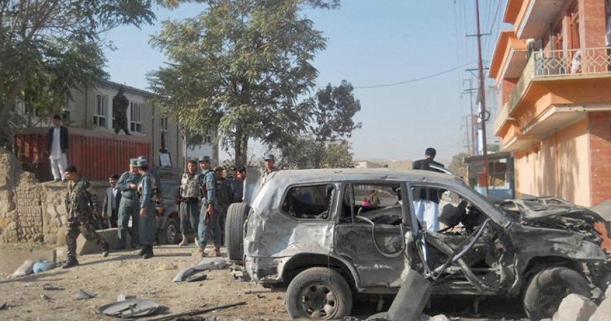 Afghan security personnel walk at the site of a suicide attack in Maymanah in Faryab province on October 17, 2011. A suicide bomber targeting the provincial head of Afghanistan's intelligence agency blew himself up, wounding the chief and killing a child in the north of the country, police said.</p>