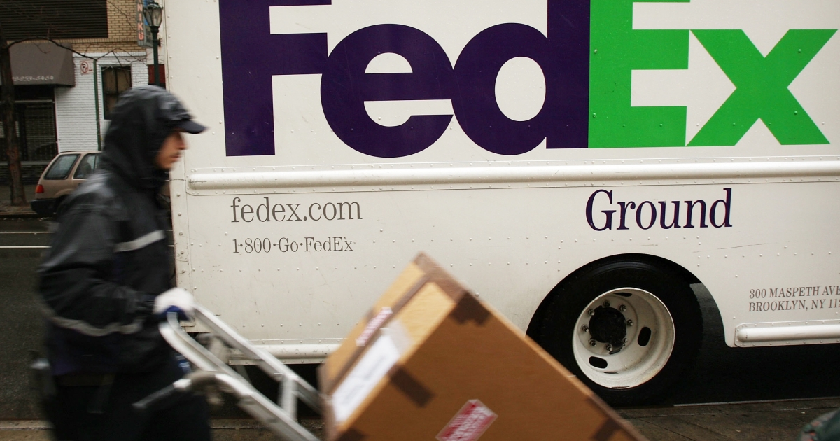 A FedEx employee delivers packages in New York City.</p>