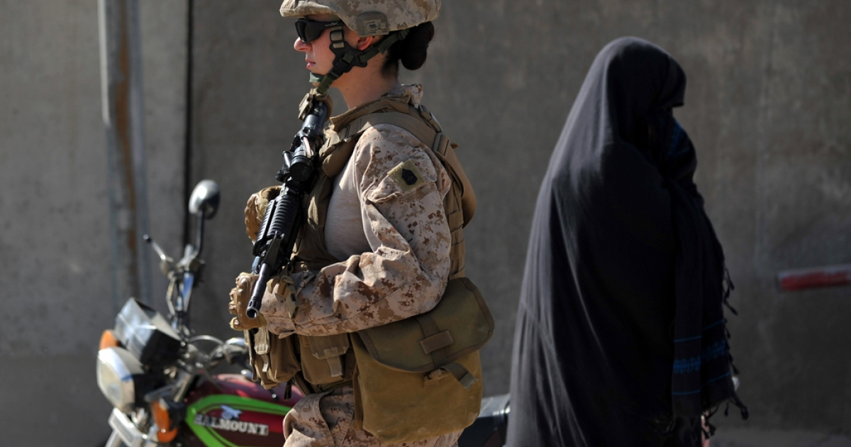 US Female Marine, Gunnery Sargeant Michelle Mollen of the 2nd Battalion, 1st Marines Regiment, patrols in Garmser, Helmand Province, Afghanistan on March 12, 2011.</p>