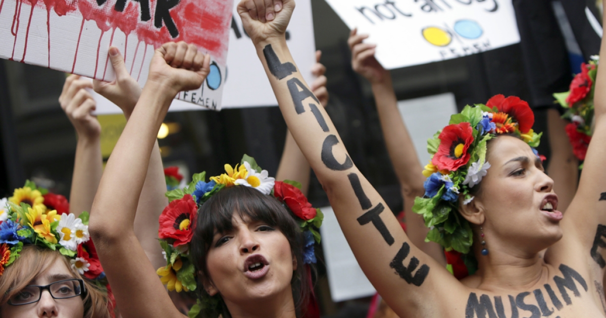 Topless activists of the Ukrainian women movement Femen protest against anti women's politic near the official Femen Centre opening today in Paris, on September 18, 2012 in Paris.</p>