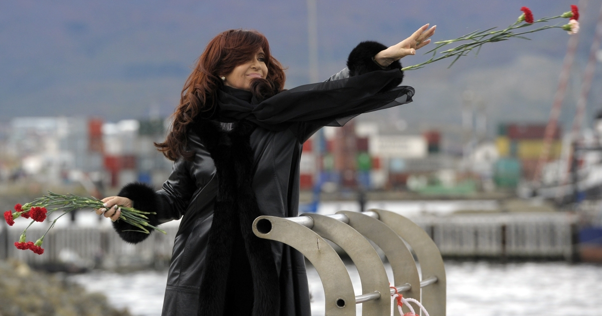 Argentine President Cristina Fernandez de Kirchner throws flowers to the sea in Terra del Fuego paying homage to the war veterans and the fallen on the 30th anniversary of the 1982 South Atlantic war between Argentina and Britain over the Falkland Islands (Malvinas).</p>