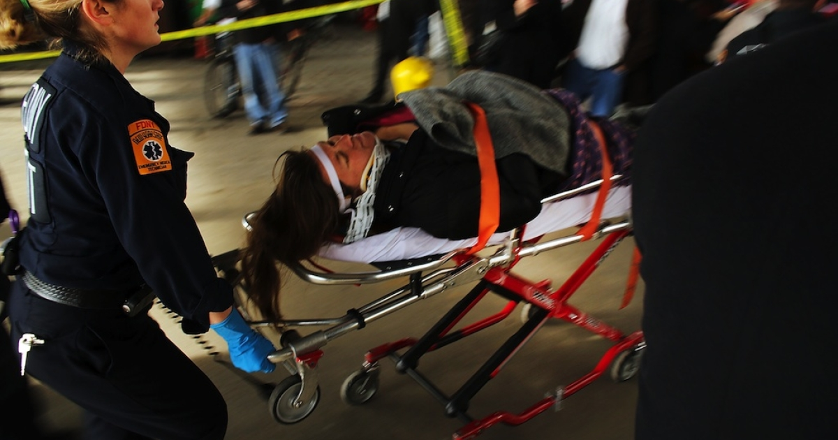 An injured person is carried to a waiting ambulance following an early morning ferry accident during rush hour in Lower Manhattan on January 9, 2013 in New York City. About 50 people were injured in the accident, which left a large gash on the front side of the Seastreak ferry at Pier 11.</p>