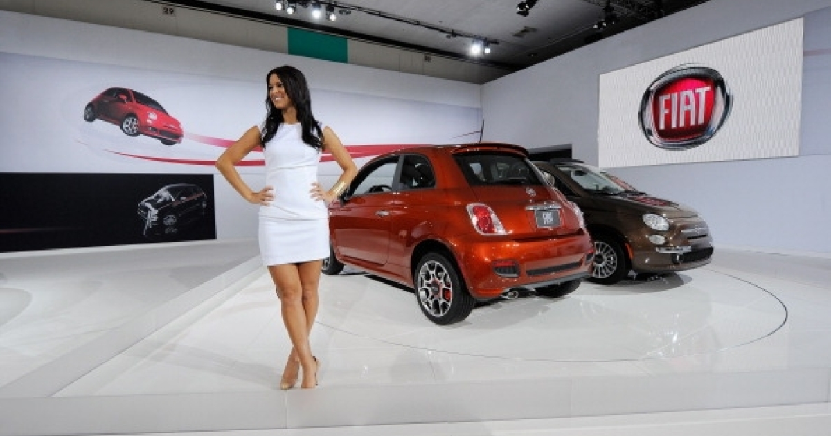Fiat, the automobile of choice for Italian car sex. Here, Fiat 500 cars are shown on display at the Los Angeles Auto Show on November 17, 2011 in Los Angeles, California.</p>