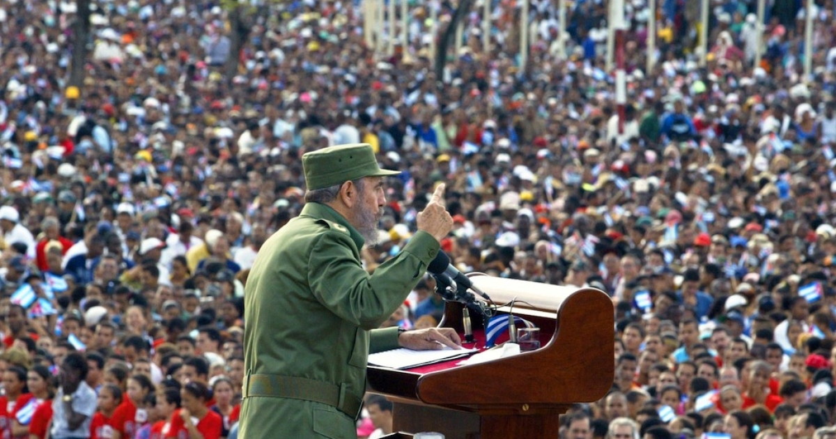 Cuban President Fidel Castro delivers a speech in front of some 500,000 Cubans in Santiago de Cuba, some 900 km (559 miles) east of Havana, 08 June 2002. It was the third Saturday rally called as a protest against the criticism of US President George W. Bush, which marked the centennial of Cuban independence, and the US State Department's decision to keep Cuba on the list of nations sponsoring terrorism.</p>