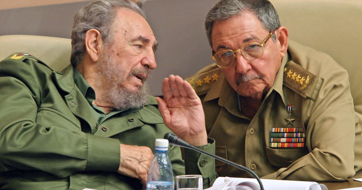 Former Cuban President Fidel Castro, left, and his brother Raúl, chat in Havana, during a meeting of the Cuban parliament in December, 2003.</p>