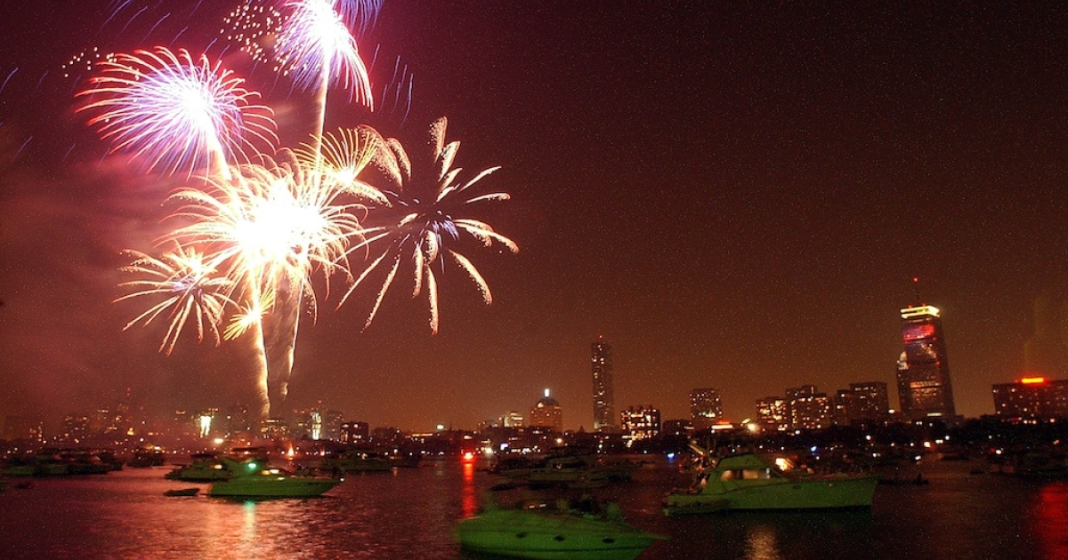 Fireworks light up the sky above the Charles River in Boston.</p>