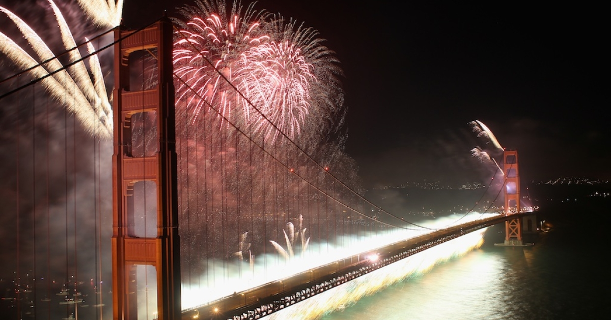 A fireworks display glows over the Golden Gate Bridge.</p>