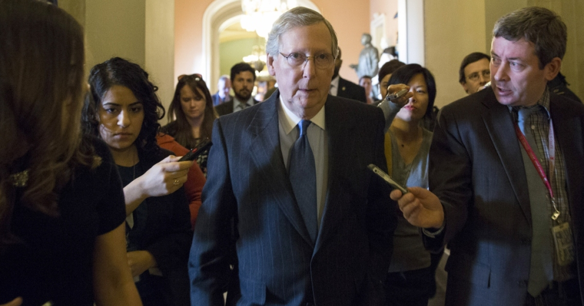 Senate Minority Leader Mitch McConnell (R-KY) on his way to fiscal cliff talks Dec. 30, 2012 in Washington, D.C.</p>