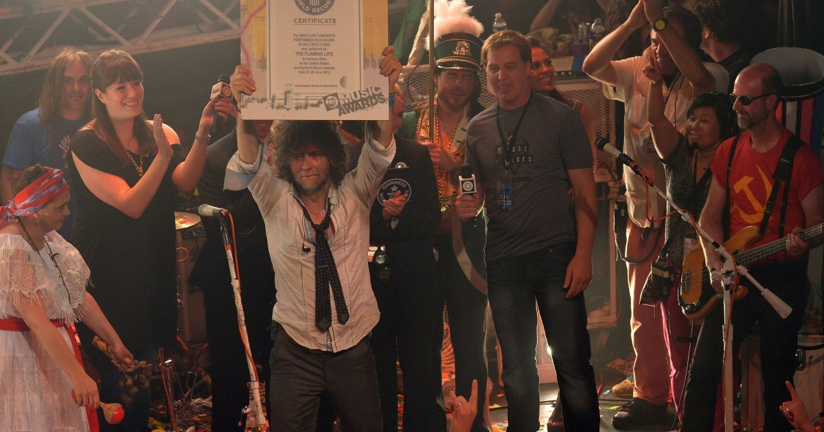 Wayne Coyne and The Flaming Lips accept a certificate from Amanda Mochan and Mike Janela from the Guinness World Records on stage during the conclusion of the MTV, VH1, CMT &amp; LOGO O Music Awards at the House of Blues on June 28, 2012 in New Orleans, Louisiana.</p>