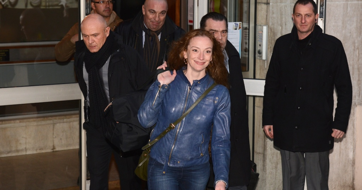 A smiling Florence Cassez leaves an apartment building shortly after arriving in Paris on Thursday.</p>