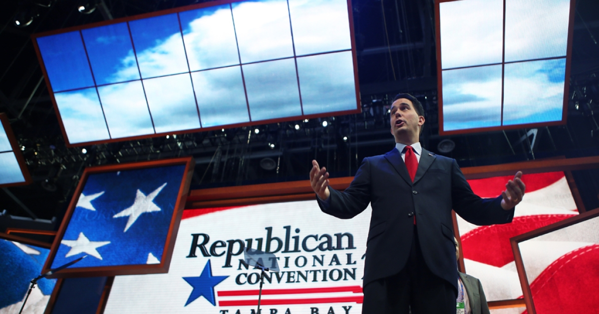 TAMPA, FL - AUGUST 26:  Wisconsin Gov. Scott Walker speaks on stage ahead of the Republican National Convention at the Tampa Bay Times Forum on August 26, 2012 in Tampa, Florida. The RNC is scheduled to convene on August 27 and will hold its first full-day session on August 28 as Tropical Storm Isaac threatens disruptions due to its proximity to the Florida peninsula.  (Photo by Chip Somodevilla/Getty Images)</p>