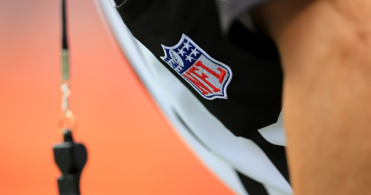 A detail of the uniform and whistle of an NFL referee.</p>
