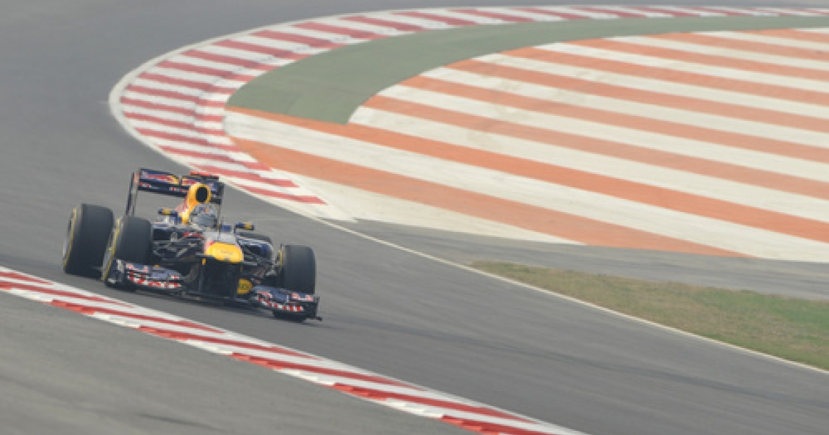 Red Bull-Renault driver Sebastian Vettel of Germany drives his car during the first practice session of Formula One's Indian Grand Prix at the Buddh International circuit in Greater Noida on October 28, 2011. India will host its first Formula One Grand Prix on October 30.</p>
