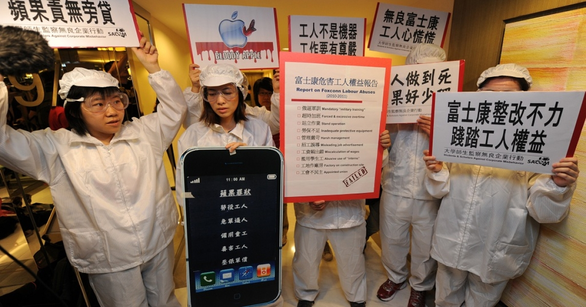 A group of protestors from SACOM (Students and Scholars Against Corporate Misbehaviour) demonstrate outside the Foxconn annual general meeting (AGM) in Hong Kong on May 18, 2011. Taiwanese technology giant Foxconn has been accused of treating its workers 'machines' according to SACOM. At least 13 Foxconn employees died in apparent suicides last year.</p>