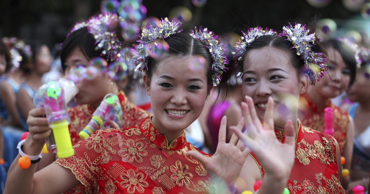 Foxconn employees enjoy a rally in Shenzhen, China, on Aug. 19, 2010. Taiwanese technology giant Foxconn held a morale-boosting, costumed
