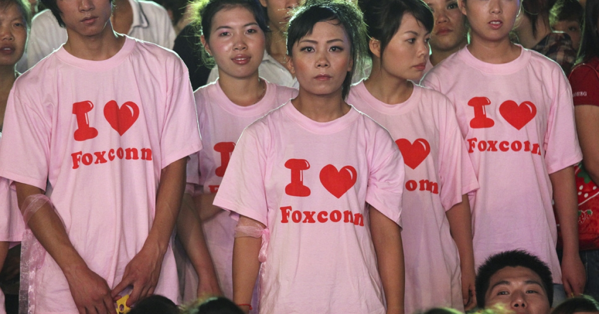 Foxconn employees attend a rally at the Foxconn campus in Shenzhen, China, on August 19, 2010. Foxconn promised wage increases of between 16 and 25 percent to answer criticism of its working conditions.</p>