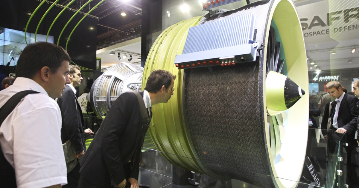 Visitors to the Paris Air Show on June 22, 2011 look at the LEAP engine by CFM, selected by Airbus to power the A320neo and by COMAC for the C919.</p>