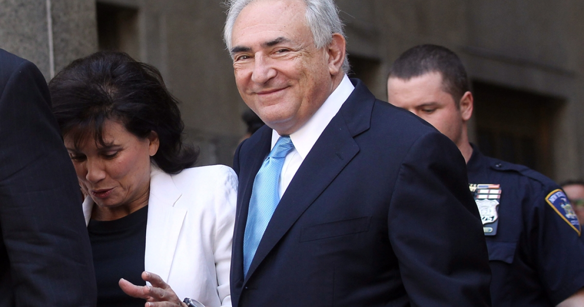 Former International Monetary Fund leader Dominique Strauss-Kahn (R) and his wife Anne Sinclair leave New York State Supreme Court for a hearing on July 1, 2011 in New York City.</p>