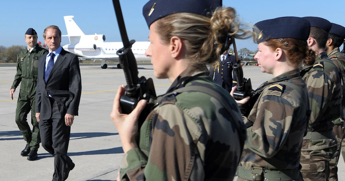 French Defense Minister Gerard Longuet reviews troops on arrival to the BA 133 air base in Nancy-Ochey, eastern France, on March 25, 2011. Mirages 2000-D from BA 133 base made the first air strikes in Libya.</p>