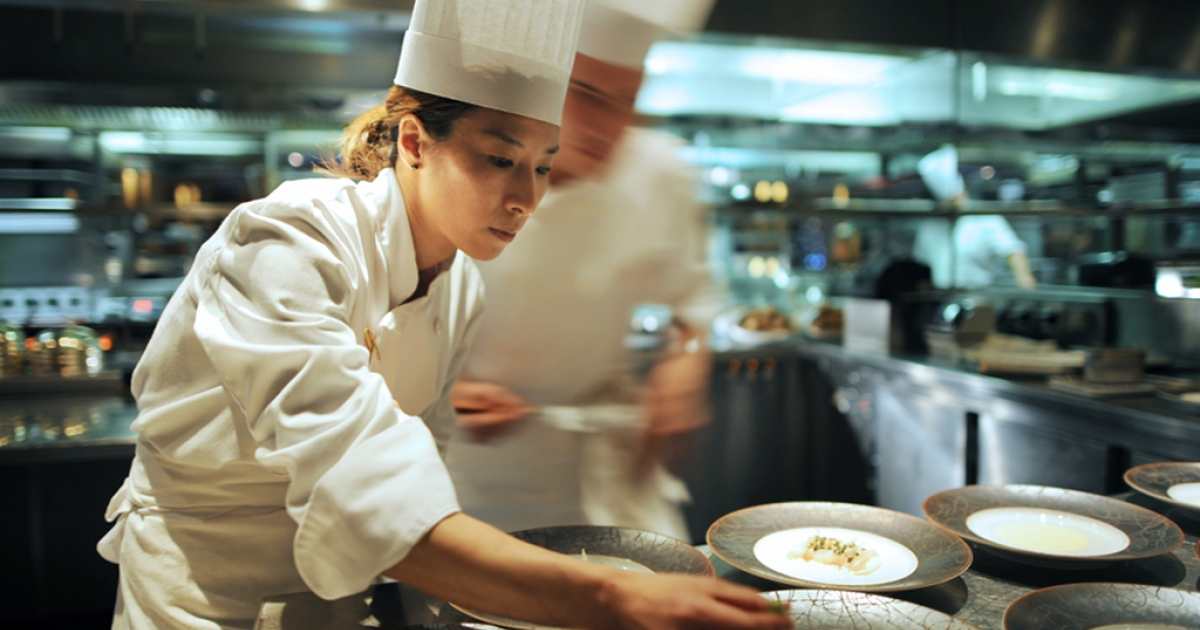 Cooks are at work on December 13, 2010 in the kitchen of the Hotel Hyatt Vendome in Paris.</p>