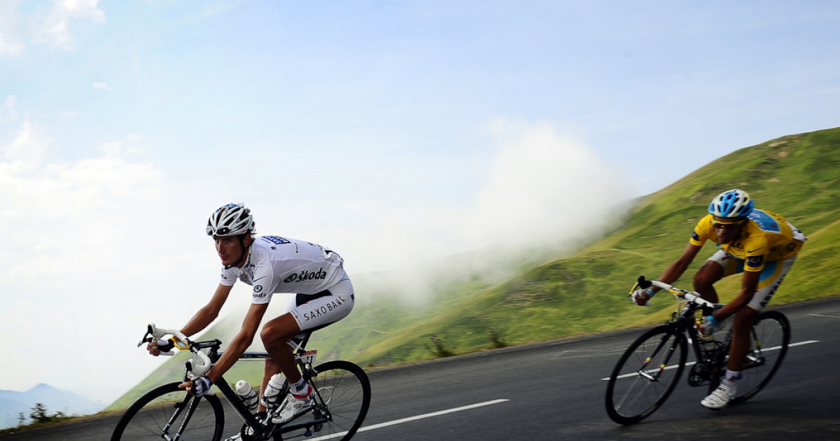 White jersey of Best Young, Luxembourg's Andy Schleck, speeds ahead of Yellow jersey of overall leader, Spain's Alberto Contador, in the descent of the Col du Tourmalet pass during the 16th stage of the 2010 Tour de France.</p>