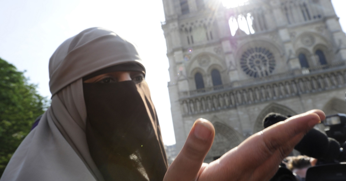 Kenza Drider, a young woman from the southern city of Avignon who has become the media symbol of France's tiny community of niqab wearers, speaks to the press during an unauthorized protest in front of Notre Dame cathedral against France's new ban on wearing full-face veils in public, on April 11, 2011 in Paris. Two women in niqabs were arrested.</p>