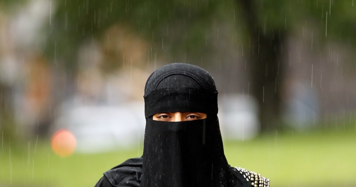 A woman wears a full face Niqab on the streets of Blackburn July 20, 2010 in Blackburn, England. Syria has banned the wearing of full face veils in it's universities. The controversial Islamic niqab and the full face burqa has also seen calls across Europe for the garment to be banned. Many Islamic groups have called the ban discrimination against Muslims.</p>