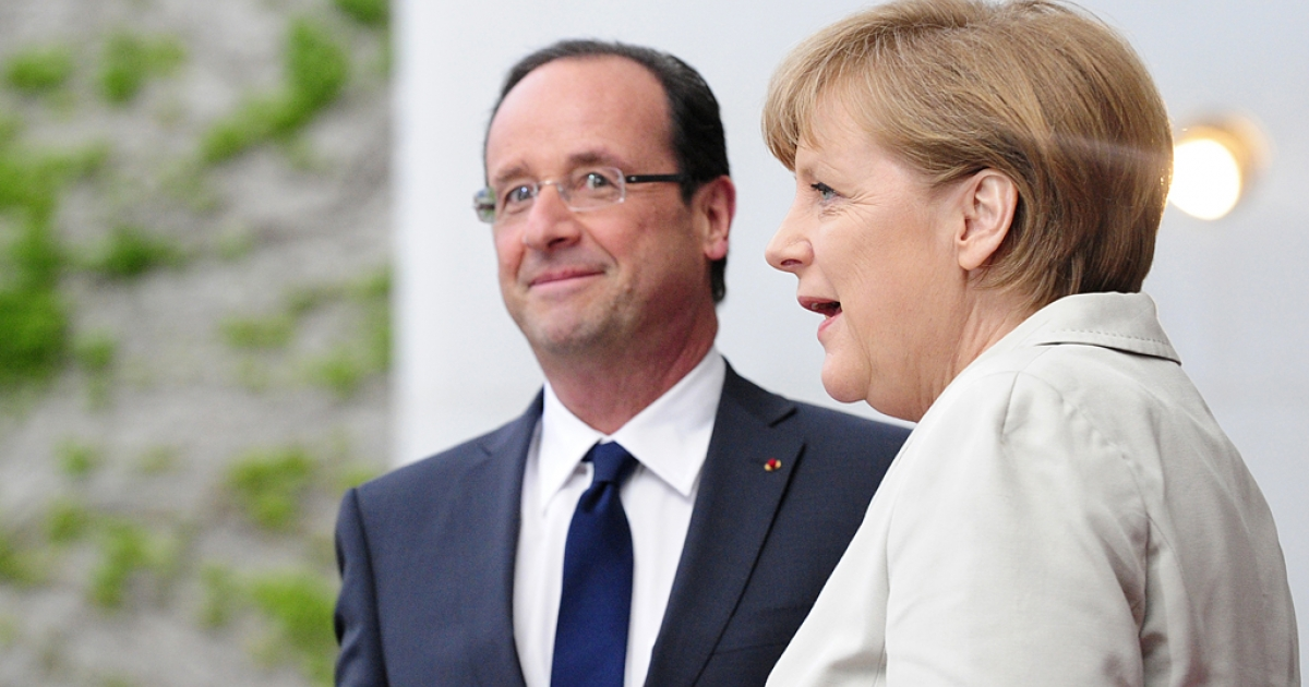 German chancellor Angela Merkel speaks with the new French president Francois Hollande as she greets him at the German Chancellery on May 15, 2012 in Berlin. Lightning hit Hollande's plane as he flew for Berlin, forcing him to turn back, and delaying his arrival.</p>