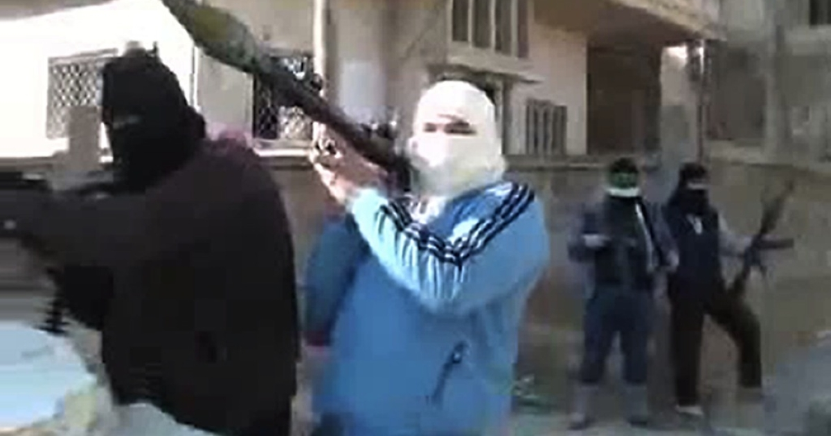 An image grab taken from a video uploaded on YouTube on January 29, 2012 shows armed men, said to be members of the Free Syrian Army (FSA), standing guard in a street in the central town of Rastan.</p>