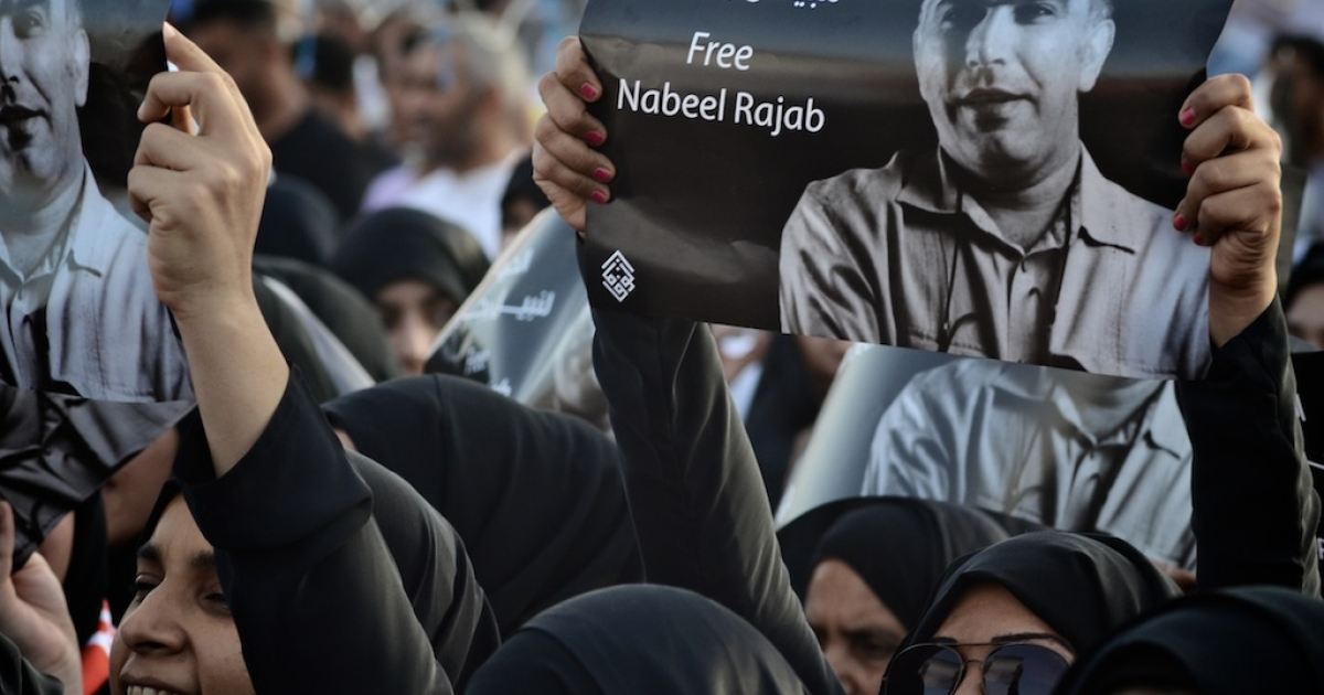 Bahraini Shiite Muslim women hold portraits of opposition prisoner, Nabeel Rajab during a demonstration in the village of Karzakan, South of the capital Manama, on May 11, 2012 to demand release of jailed opposition activists.</p>