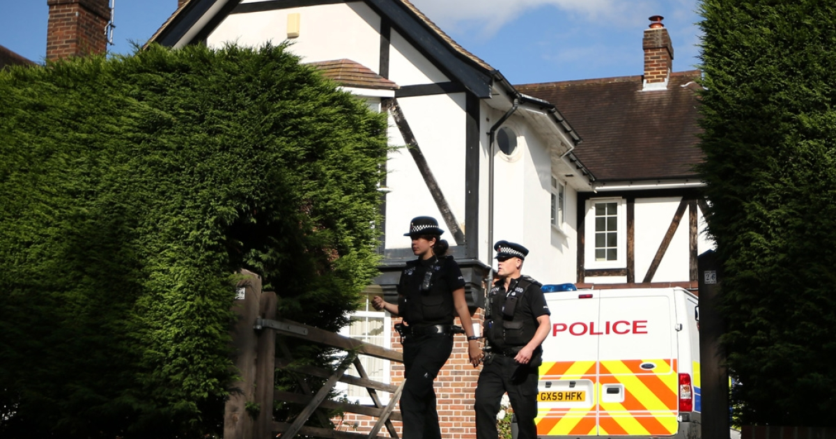 Police stand outside the home of Saad al-Hilli on September 14, 2012 in Claygate, England. Investigations are continuing after a British family was murdered in the French Alps on September 5, 2012.</p>