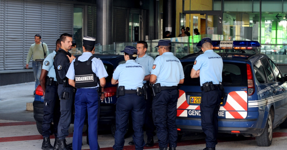Police gather on September 8, 2012 in front of the CHU Hospital in Grenoble, France where Zainab al-Hilli, one of two daughters of a British-Iraqi family, is staying after a shooting on September 5 near the village of Chevaline.</p>