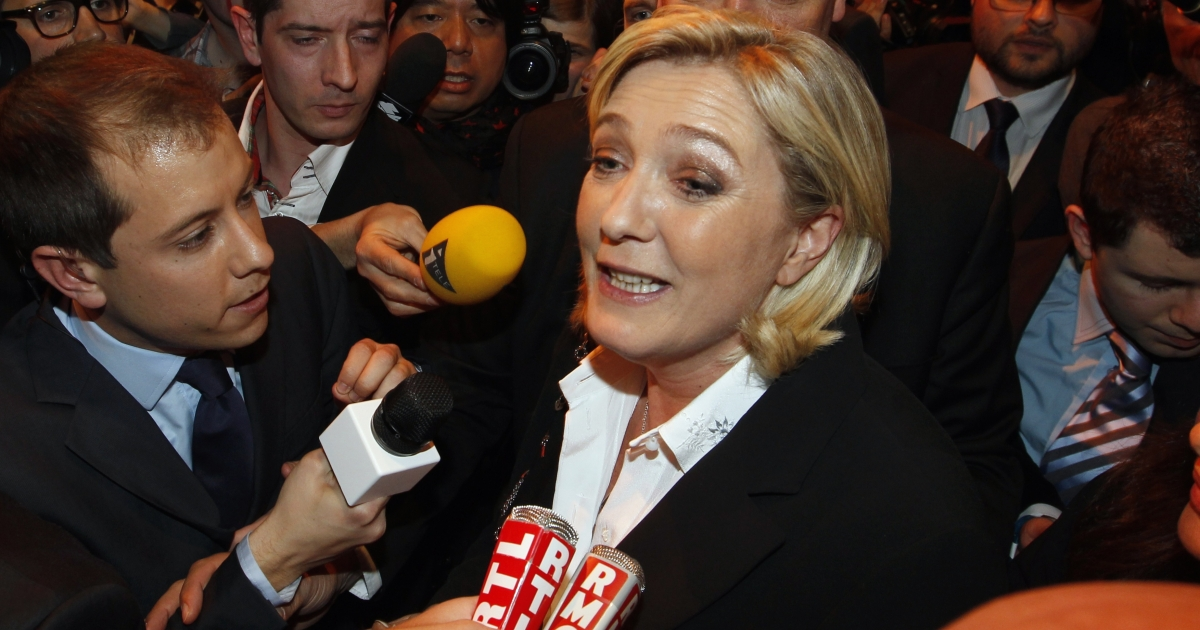 Le Pen is surrounded by reporters today during the election night rally of her party in Paris.</p>