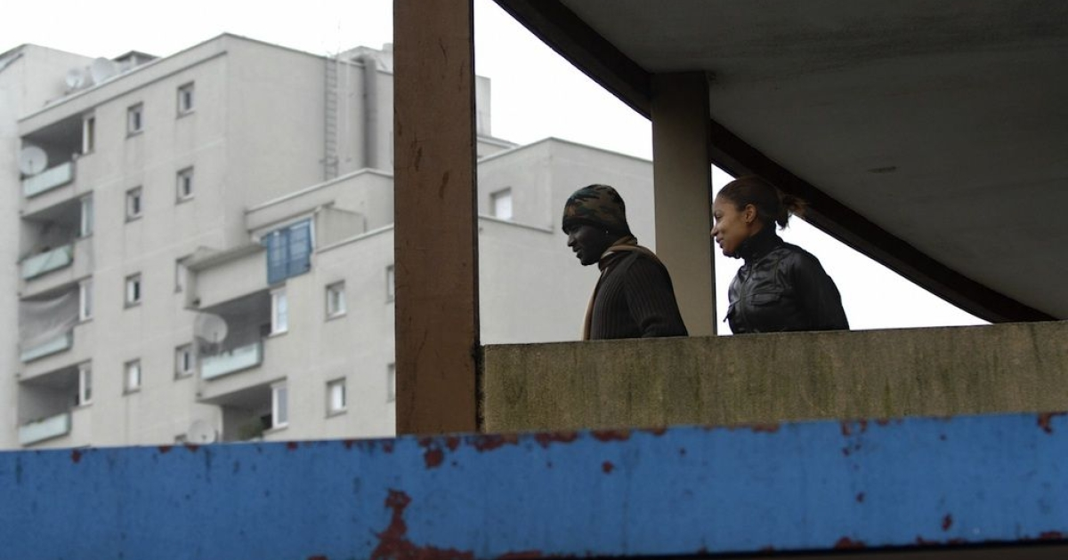 Clichy-sous-Bois, FRANCE: Young people stand next to the Maison Blanche association of the Bois du Temple housing project. Aid from Qatar could filter into Plaisir, another French housing project, if the project's application is approved by the Gulf state.</p>