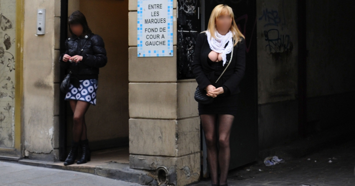 Picture of prostitutes on rue Saint-Denis in Paris, one of the red light districts of France's capital.</p>