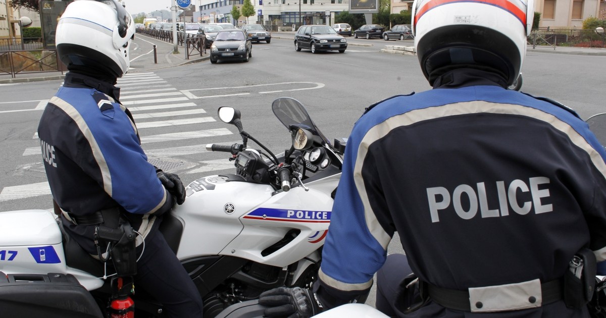 French motorcycle police survey traffic on April 7 in Viry-Chatillon south of Paris. Hundreds of extra police were drafted into the Paris suburbs where four murders have been carried out with the same weapon since November.</p>