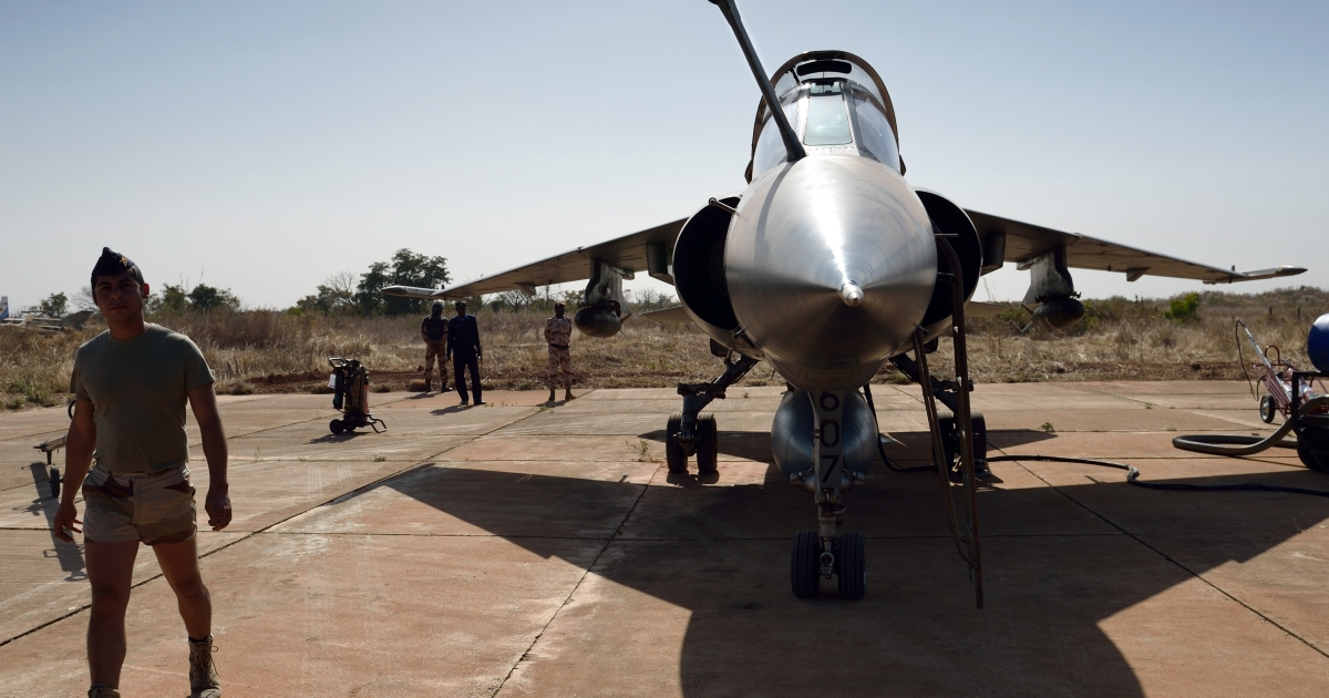 A French soldier near a Mirage fighter jet near Bamako, Mali. Islamist groups have warned France has
